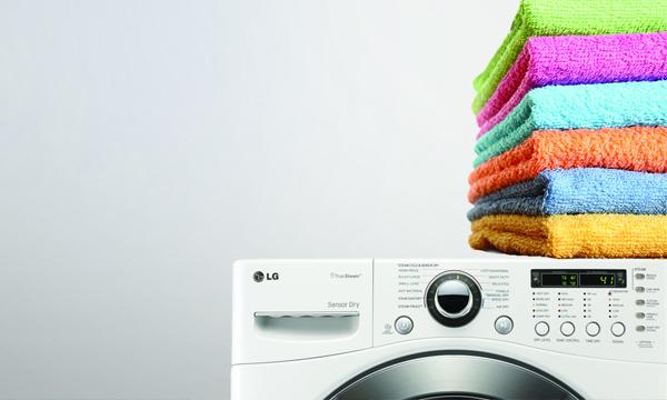 primera lavadora secadora cocina pequeña